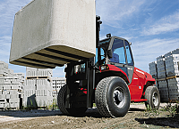 Image of forklift truck with block of concrete